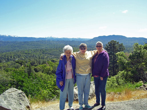 Three ladies about to slide into the valley at Oakhurst!